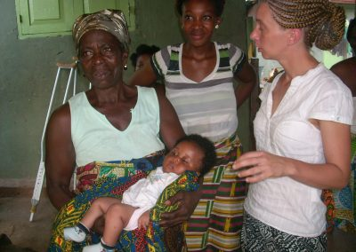 Nadine with a mother and community-based midwife